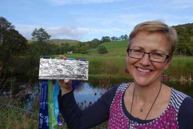 Designer George Grange With The New Asics Windermere Marathon Medals